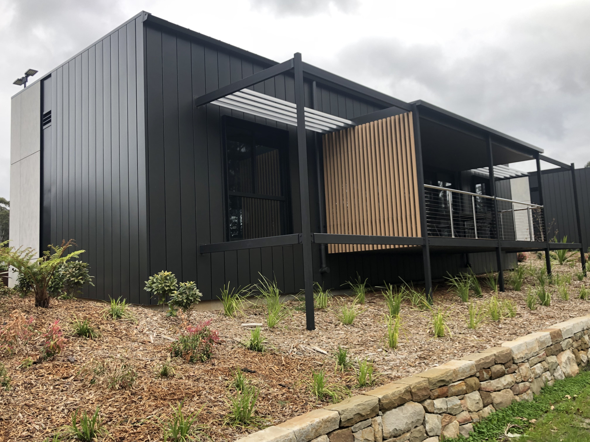 9-Sunshade-and-decking-out-of-the-cladding